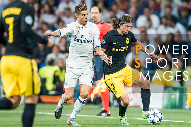 Filipe Luis (r) of Atletico de Madrid fights for the ball with Cristiano Ronaldo of Real Madrid during their 2016-17 UEFA Champions League Semifinals 1st leg match between Real Madrid and Atletico de Madrid at the Estadio Santiago Bernabeu on 02 May 2017 in Madrid, Spain. Photo by Diego Gonzalez Souto / Power Sport Images