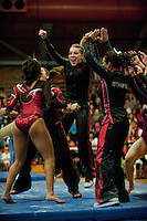 STANFORD, CA-JANUARY 22, 2012 - Nicole Dayton celebrates a her teammate's successful beam routine en route to Stanford's win over the visiting University of Washington Gym Dawgs at Burnham Pavilion on the Stanford Campus.