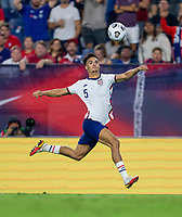 NASHVILLE, TN - SEPTEMBER 5: Antonee Robinson #5 of the United States tries to control the ball during a game between Canada and USMNT at Nissan Stadium on September 5, 2021 in Nashville, Tennessee.