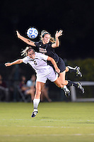 Texas defender Isabelle Kerr (14) lands on Texas State forward Lauren Prater (6) while going up for the ball during an NCAA soccer game, Sunday, September 21, 2014 in San Marcos, Tex. Texas defeated Texas State 2-0. (Mo Khursheed/TFV Media via AP Images)