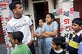 Members of a Bangladeshi family outside their flat on an estate close to Brick Lane in Tower Hamlets, east London.