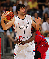 BELGRADE, SERBIA - JULY 09: Milos Teodosic (L) of Serbia in action against John Holland (R) of Puerto Rico during the 2016 FIBA World Olympic Qualifying basketball Final match between Serbia and Puerto Rico at Kombank Arena on July 09, 2016 in Belgrade, Serbia. (Photo by Srdjan Stevanovic/Getty Images)