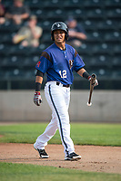 Missoula Osprey shortstop Brandon Leyton (12) walks to the dugout after striking out during a Pioneer League game against the Orem Owlz at Ogren Park Allegiance Field on August 19, 2018 in Missoula, Montana. The Missoula Osprey defeated the Orem Owlz by a score of 8-0. (Zachary Lucy/Four Seam Images)