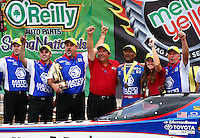 Apr 27, 2014; Baytown, TX, USA; NHRA top fuel dragster driver Antron Brown celebrates with team owner Don Schumacher and crew after winning the Spring Nationals at Royal Purple Raceway. Mandatory Credit: Mark J. Rebilas-