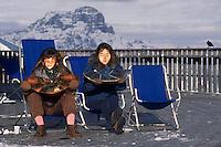 - Cortina d'Ampezzo, girls sunbathing on terrace of mounts Tofane refuge....- Cortina d'Ampezzo, ragazze prendono il sole sulla terrazza del rifugio monti Tofane