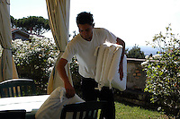 Camerieri preparano i tavoli per il pranzo in giardino..Waiters prepare tables for lunch in the garden...Villa Grazioli è un raffinato albergo della catena internazionale Relais & Chateaux..Fu costruita dal Cardinale Antonio Carafa nel 1580 e racchiude tra le sue mura opere d'arte dei maestri del XVI e XVII secolo, Ciampelli, Carracci e G.P. Pannini. .Villa Grazioli is a sophisticated international hotel chain Relais & Chateaux. .It was built by Cardinal Antonio Carafa in 1580 and contains works of art of the sixteenth and seventeenth century, of Ciampelli, Carracci and GP Pannini....