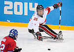 Sochi, RUSSIA - Mar 11 2014 -  Dominic Larocque makes a pass as Canada takes on Czech Republic in Sledge Hockey at the 2014 Paralympic Winter Games in Sochi, Russia.  (Photo: Matthew Murnaghan/Canadian Paralympic Committee)