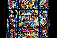 Stained glass window made in 1954 illustrating the grape harvest and wine and champagne making process in the cathedral of Notre-Dame de Reims, Reims, France, 11 November 2015