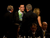 Seattle Coach Sigi Schmid talks to Mike Seamon of Villanova  after he was the 27th overall pick of  the MLS Superdraft by the Seattle Sounders at the Pennsylvania Convention Center in Philadelphia, PA.