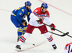 (L) Henrik Zetterberg of Sweden competes for the ice past with (R) Jaromir Jagr of Czech Republic during the match between Sweden vs Czech Republic during their Men's Ice Hockey Preliminary Round Group C game on day five of the 2014 Sochi Olympic Winter Games at Bolshoy Ice Dome on February 12, 2014 in Sochi, Russia. Photo by Victor Fraile / Power Sport Images