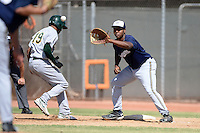 Milwaukee Brewers first baseman David Denson (8) takes a throw as D'Arby Myers (19) gets back to the bag during an Instructional League game against the Oakland Athletics on October 10, 2013 at Maryvale Baseball Park Training Complex in Phoenix, Arizona.  (Mike Janes/Four Seam Images)