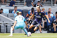 ST PAUL, MN - JULY 18: Kelyn Rowe #22 of the Seattle Sounders FC works to get past Chase Gasper #77 of Minnesota United FC during a game between Seattle Sounders FC and Minnesota United FC at Allianz Field on July 18, 2021 in St Paul, Minnesota.