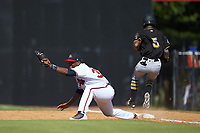 Nicholas Vizcaino (36) of the Danville Braves stretches for a throw as Victor Ngoepe (5) of the Bristol Pirates crosses first base at American Legion Post 325 Field on July 1, 2018 in Danville, Virginia. The Braves defeated the Pirates 3-2 in 10 innings. (Brian Westerholt/Four Seam Images)