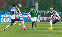 Mexico City, Mexico - Sunday June 11, 2017: Geoff Cameron, Carlos Vela, Michael Bradley during a 2018 FIFA World Cup Qualifying Final Round match with both men's national teams of the United States (USA) and Mexico (MEX) playing to a 1-1 draw at Azteca Stadium.