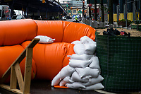 """NEW YORK, NY - AUGUST 4: Water barriers used to prevent flooding are seen at the South Street Seaport as city gets ready for tropical storm Isaias on August 4, 2020 in New York City. The Tri-State area """"New York, New Jersey and Connecticut"""" is preparing for torrential rain, strong winds from Tropical storm Isaias. (Photo by Eduardo MunozAlvarez/VIEWpress)"""
