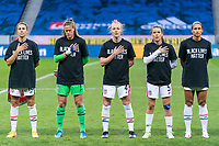 SOLNA, SWEDEN - APRIL 10: Carli Lloyd #10, Alyssa Naher #1, Becky Sauerbrunn #4, Kelley O'Hara #5 and Lynn Williams #6 of the USWNT stand for the national anthem before a game between Sweden and USWNT at Friends Arena on April 10, 2021 in Solna, Sweden.