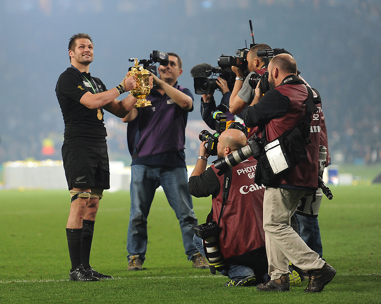 Richie McCaw of New Zealand lifts the Webb Ellis trophy as he is surrounded by press after  winning the Rugby World Cup Final between New Zealand and Australia - 31/10/2015 - Twickenham Stadium, London<br /> Mandatory Credit: Rob Munro/Stewart Communications
