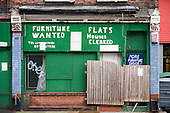 Boarded-up used furniture shop in Bermondsey.