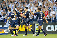 MELBOURNE, AUSTRALIA - FEBRUARY 18, 2010: Nik Mrdja from Melbourne Victory celebrates kicking a goal in the first leg of the A-League Major Semi Final match between the Melbourne Victory and Sydney FC at Etihad Stadium on February 18, 2010 in Melbourne, Australia. Photo Sydney Low www.syd-low.com