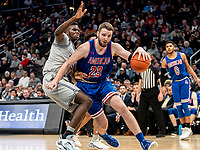 WASHINGTON, DC - DECEMBER 28: Mark Gasperini #23 of American pushes past Qudus Wahab #34 of Georgetown. during a game between American University and Georgetown University at Capital One Arena on December 28, 2019 in Washington, DC.