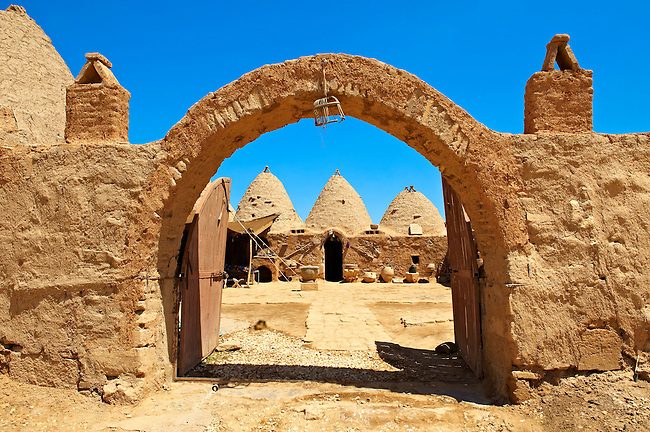 """Pictures of the beehive adobe buildings of Harran, south west Anatolia, Turkey.  Harran was a major ancient city in Upper Mesopotamia whose site is near the modern village of Altınbaşak, Turkey, 24 miles (44 kilometers) southeast of Şanlıurfa. The location is in a district of Şanlıurfa Province that is also named """"Harran"""". Harran is famous for its traditional 'beehive' adobe houses, constructed entirely without wood. The design of these makes them cool inside. 11"""