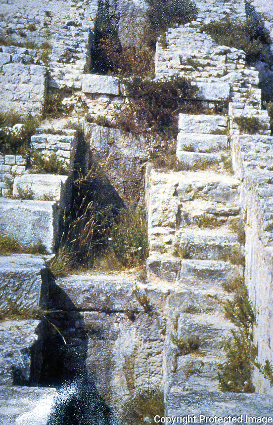 """Roman Technology:  Ruins of  Mills at Barbegal.  Foundations and containments of 16 water wheels.  A. Trevor Hodge, """"A ROMAN FACTORY"""", Science America.  Photo '91."""