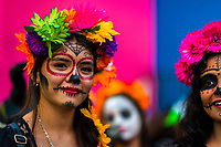 Young Mexican women, dressed as La Catrina, a Mexican pop culture icon representing the Death, take part in the Day of the Dead celebrations in Oaxaca, Mexico, 31 October 2019. Day of the Dead (Día de Muertos), a religious holiday combining the death veneration rituals of Pre-Hispanic cultures with the Catholic practice, is widely celebrated throughout all of Mexico. Based on the belief that the souls of the departed may come back to this world on that day, people gather together while either praying or joyfully eating, drinking, and playing music, to remember friends or family members who have died and to support their souls on the spiritual journey.