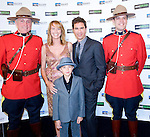 BANFF, AB, CANADA - JUNE 15:  Actor Eric McCormack, second left, with his wife Janet Holden and son Finnigan pose with Canadian Mounted Police on the red carpet before the 2010 Banff World Television awards on June 15, 2010 at the Banff Springs Hotel in Banff, Alberta, Canada. Photo by Jimmy Jeong *** Local Caption *** Eric McCormack;Janet Holden;Finnigan McCormack