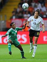 Celia Okoyino da Mbabi (r) of team Germany and Stella Mbachu of team Nigeria during the FIFA Women's World Cup at the FIFA Stadium in Frankfurt, Germany on June 30th, 2011.