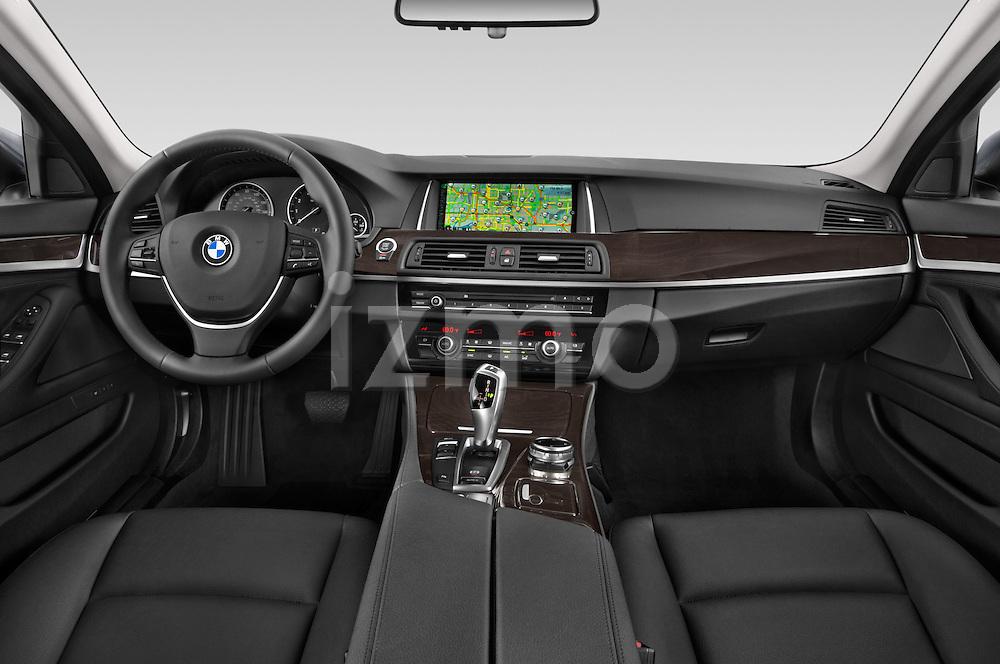 Stock photo of straight dashboard view of a 2015 BMW 5 Series 528i 4 Door Sedan Dashboard