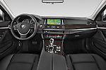 Stock photo of straight dashboard view of a 2015 BMW 5 Series 528i 4 Door Sedan Dashboard