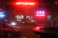 China. Jilin Province. Nightime in downtown Yanji, close to the border with North Korea. The town is part of the Korean Autonomous Prefecture in the north-east of the country. 2011