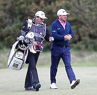 Sunday 31st May 2015; Graeme McDowell, Northern Ireland, and caddie Ken Conboy head up the 18th fairway<br /> <br /> Dubai Duty Free Irish Open Golf Championship 2015, Round 4 County Down Golf Club, Co. Down. Picture credit: John Dickson / DICKSONDIGITAL