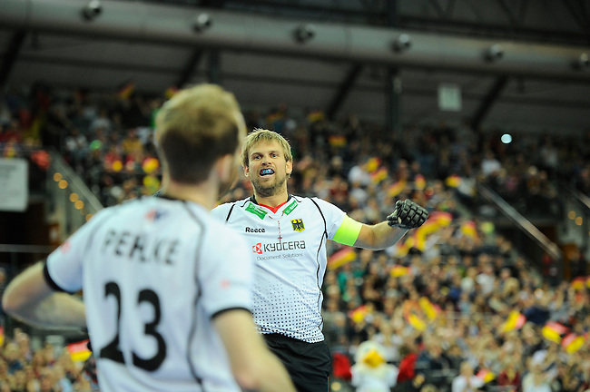Leipzig, Germany, February 08: Moritz Fuerste #21 of Germany celebrates after Fabian Pehlke #23 of Germany scores during the men bronze medal match between Germany (white) and Iran (red) on February 8, 2015 at the FIH Indoor Hockey World Cup at Arena Leipzig in Leipzig, Germany. Final score 13-2. (Photo by Dirk Markgraf / www.265-images.com) *** Local caption ***