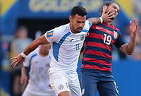 Cleveland, OH - Saturday July 15, 2017: Juan Barrera, Graham Zusi during a 2017 Gold Cup match between the men's national teams of the United States (USA) and Nicaragua (NCA) at FirstEnergy Stadium.