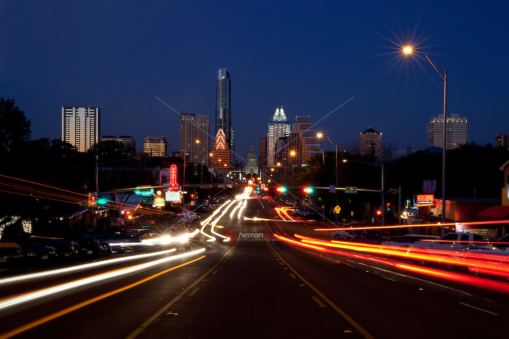 Time exposure photo downtown Austin Texas Modern City night time Skyline as seen from South Congress