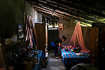 """November 10, 2014. """"Water it´s the real thing""""<br /> Corina with her daughter Susan in her house of Nejapa (El Salvador).<br />  The people of Nejapa have no drinking water because the Coca -Cola company overexploited the aquifer in the area, the most important source of water in this Central American country. This means that the population has to walk for hours to get water from wells and rivers. The problem is that these rivers and wells are contaminated by discharges that makes Coca- Cola and other factories that are installed in the area. The problem can increase: Coca Cola company has expansion plans, something that communities and NGOs want to stop. To make a liter of Coca Cola are needed 2,4 liters of water. ©Calamar2/ Pedro ARMESTRE"""