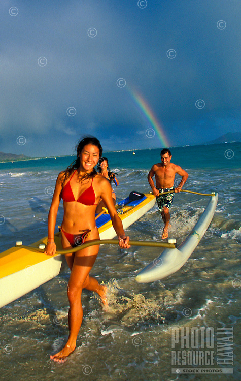 Family with outrigger canoe