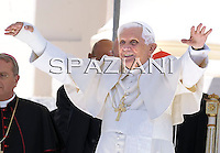 Pope Benedict XVI delivers his Angelus prayer in Romano Canavese, northern Italy, Sunday, July 19, 2009. The pope blessed a few hundred faithful Sunday with his right arm in a cast during his first public appearance since undergoing surgery to set a wrist he fractured in a fall.