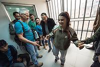 Sehid Xebat Hospital unter YPG-Verwaltung in Qamishli, Rojava/Syrien.<br /> Im Bild: Eine Kaempferin der YPJ, der Fraueneinheit in der Armee der YPG, wurde in Kobane angeschossen und im Krankenhaus operiert. Trotz der OP wird sie weiterhin unter Laehmungen in den Beinen leiden.<br /> Links im Bild: Ein Arzt der fuer die medizinische Hilfsorganisation PHNX aus Deutschland eine Recherchereise zu medizinischen Einrichtungen gemacht hat. <br /> 14.12.2014, Qamishli/Rojava/Syrien<br /> Copyright: Christian-Ditsch.de<br /> [Inhaltsveraendernde Manipulation des Fotos nur nach ausdruecklicher Genehmigung des Fotografen. Vereinbarungen ueber Abtretung von Persoenlichkeitsrechten/Model Release der abgebildeten Person/Personen liegen nicht vor. NO MODEL RELEASE! Nur fuer Redaktionelle Zwecke. Don't publish without copyright Christian-Ditsch.de, Veroeffentlichung nur mit Fotografennennung, sowie gegen Honorar, MwSt. und Beleg. Konto: I N G - D i B a, IBAN DE58500105175400192269, BIC INGDDEFFXXX, Kontakt: post@christian-ditsch.de<br /> Bei der Bearbeitung der Dateiinformationen darf die Urheberkennzeichnung in den EXIF- und  IPTC-Daten nicht entfernt werden, diese sind in digitalen Medien nach §95c UrhG rechtlich geschuetzt. Der Urhebervermerk wird gemaess §13 UrhG verlangt.]
