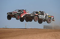 Apr 17, 2011; Surprise, AZ USA; LOORRS driver Chris Brandt (82) races alongside Brian Deegan (38) during round 4 at Speedworld Off Road Park. Mandatory Credit: Mark J. Rebilas-