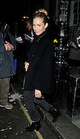 "SIENNA MILLER .Departed after the first preview performance of ""Flare Path"", Haymarket, London, England, UK, 4th March 2011..full length black coat cape grey gray jeans denim side smiling .CAP/CAN.©Can Nguyen/Capital Pictures."