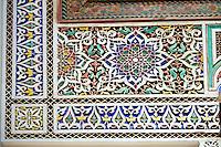 Berber Arabesque painted mocarabe plasterwork  of the Marrakesh museum in the Dar Menebhi Palace, Marrakesh, Morocco
