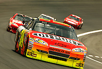 The No. 24 DuPont Chevrolet, driven by Jeff Gordon for Hendrick Motorsports, leads the pack during a lap of the 2009 Coca-Cola Classic 600 race at the Lowe's Motor Speedway, in Concord, NC. NASCAR Driver David Reutimann ultimately won the race, and his first Sprint Cup, during the rain-shortened event, held May 25, 2009. NASCAR's longest scheduled race went only 227 laps, or 340.5 miles, before officials ended it because of rain. The 2009 race was the 50th running of the Coca-Cola 600. Ryan Newman and Robby Gordon finished second and third respectively.