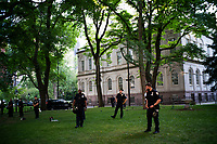 NEW YORK, NEW YORK - June 25: NYPD officers stand guard inside NYC City Hall as Demonstrators take part in a protest encampment near NYC City hall on June 25, 2020 in New York, NY. Demonstrators are calling for $1 billion in cuts of NYPD, as they protest encampment near City Hall and NYPD headquarters ahead of the city July 1 budget deadline.  (Photo by Eduardo MunozAlvarez/VIEWpress)