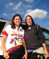 Aug. 7, 2011; Kent, WA, USA; NHRA top alcohol funny car driver Alexis DeJoria celebrates with funny car driver Melanie Troxel (left) after winning the Northwest Nationals at Pacific Raceways. Mandatory Credit: Mark J. Rebilas-
