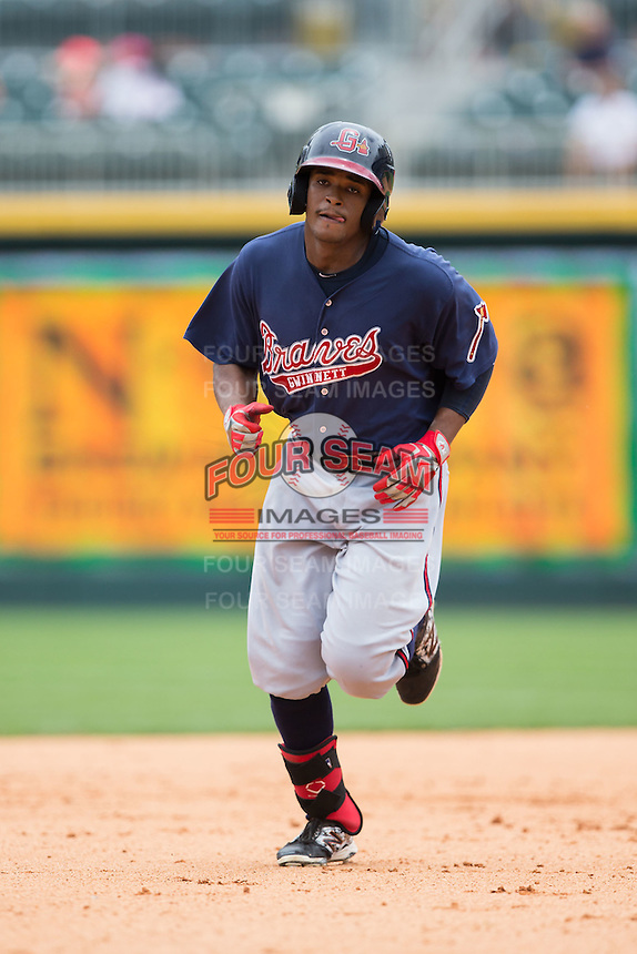Cedric Hunter (27) of the Gwinnett Braves rounds the bases after hitting a home run against the Charlotte Knights at BB&T BallPark on July 3, 2015 in Charlotte, North Carolina.  The Braves defeated the Knights 11-4 in game one of a day-night double header.  (Brian Westerholt/Four Seam Images)