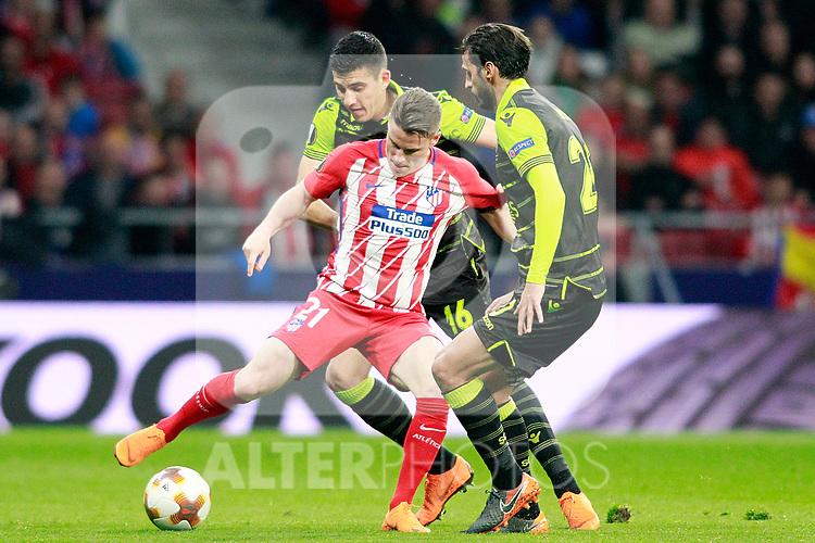 Atletico de Madrid's Kevin Gameiro (f) and Sporting Clube de Portugal's Rodrigo Battaglia (b) and Bryan Ruiz during Europa League Quarter-finals, 1st leg. April 5,2018. (ALTERPHOTOS/Acero)