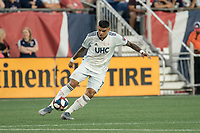 FOXBOROUGH, MA - AUGUST 3: Gustavo Bao #7 of New England Revolution advances the ball during a game between Los Angeles FC and New England Revolution at Gillette Stadium on August 3, 2019 in Foxborough, Massachusetts.