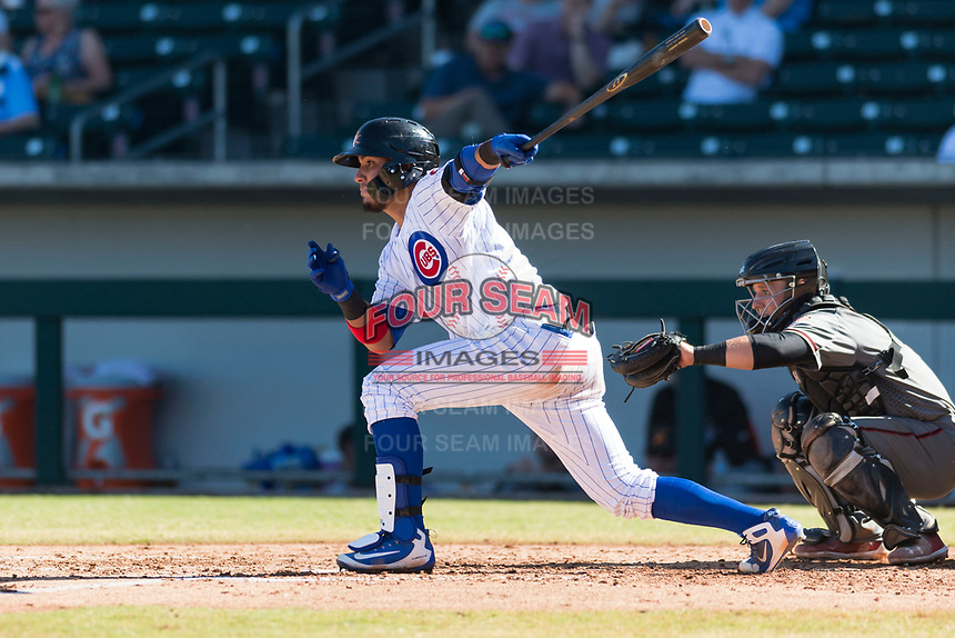 Mesa Solar Sox catcher Jhonny Pereda (6), of the Chicago Cubs organization, follows through on his swing in front of catcher Daulton Varsho (8) during an Arizona Fall League game against the Salt River Rafters at Sloan Park on October 30, 2018 in Mesa, Arizona. Salt River defeated Mesa 14-4 . (Zachary Lucy/Four Seam Images)